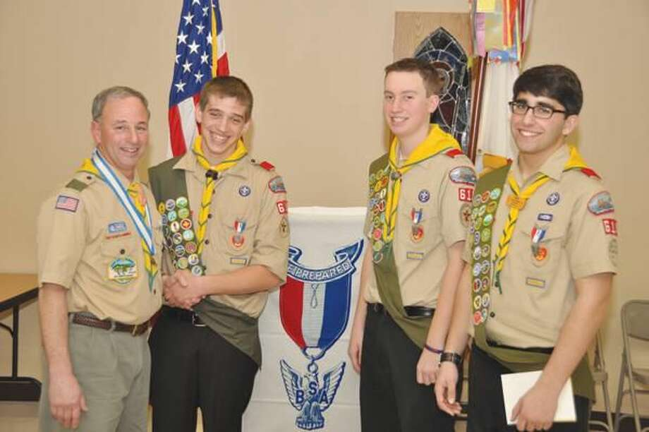Submitted Photo Scoutmaster William F. Earley Jr., left, congratulates Troop 610 Eagle Scouts James Grahn, Alex Feldman and Andrew Roseman (left to right).