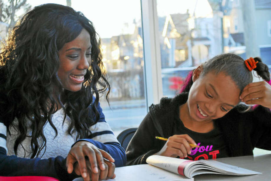 New Haven Reads volunteer tutor Vimbai Ushe and student Bella Gomez-Stafford.