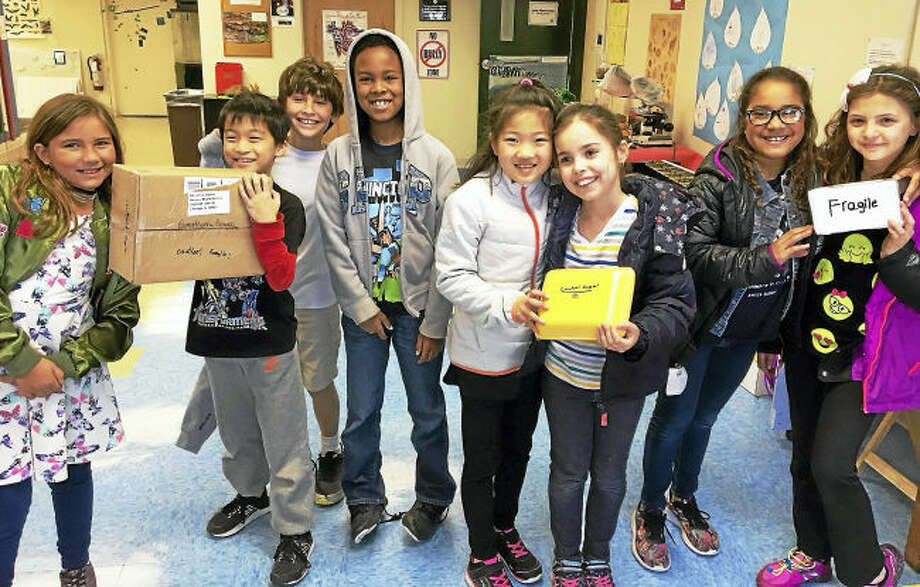 Contributed photo. Hamden Hall Country Day School third graders took part in the national Pringles Challenge, which involved designing a package that would safely ship a single potato chip through the US Postal Service.