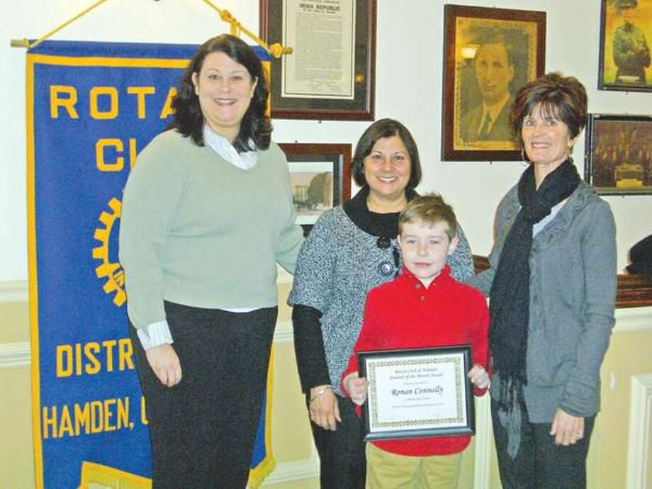 Submitted Photo Pictured are Rotarian Joena Russell, Principal Vanessa Ditta, and classroom para-professional Kelly Gaffney along with Student of the Month Ronan Connolly.