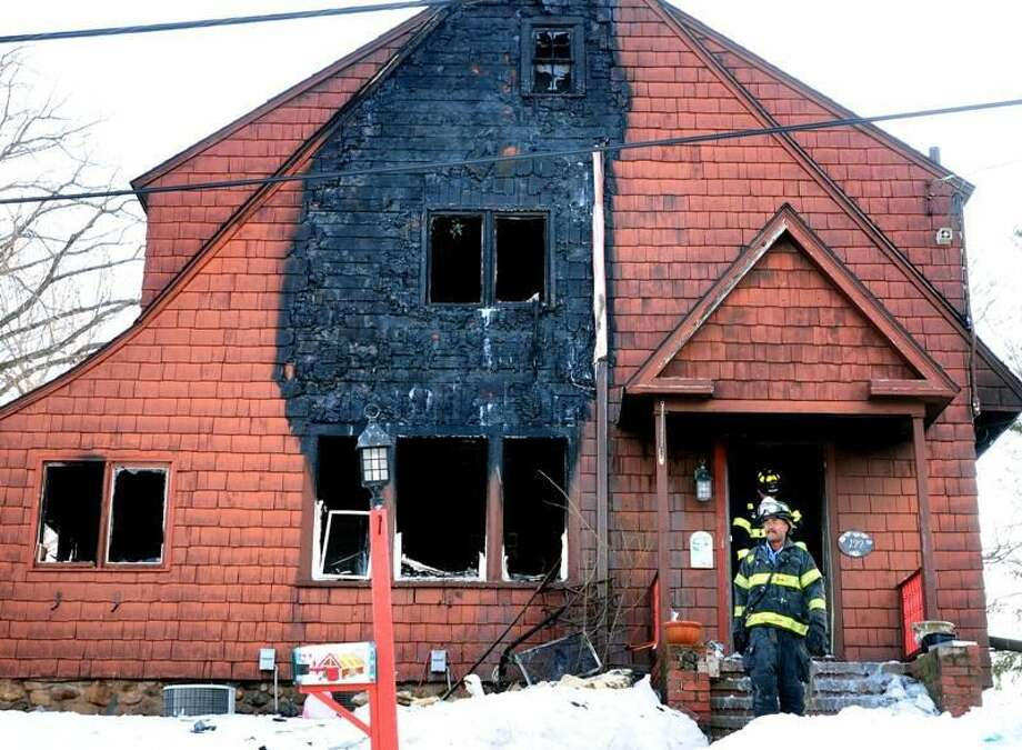 Photo by Arnold Gold Firefighters at scene of fatal Hamden blaze.
