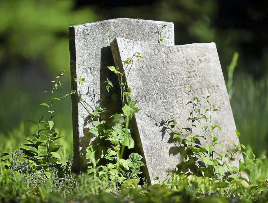 A broken gravestone at the State Street Cemetery at 2150 State Street in Hamden photographed Friday was established in 1799.