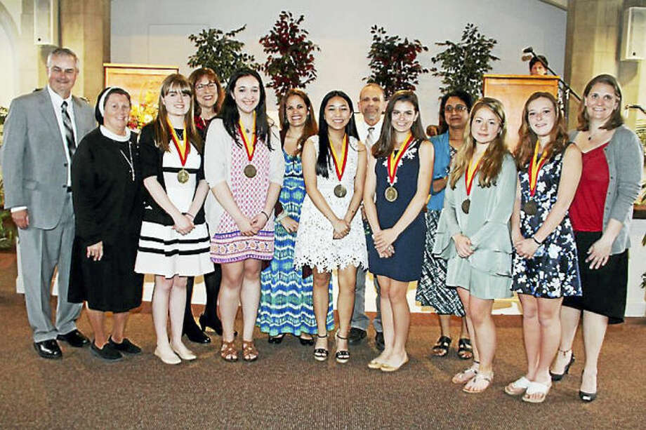 Photo Courtesy of Catholic Transcript.  From left, Superintendent of schools Archdiocese of Hartford Dr. Michael S. Griffin; Principal Sr. Kathleen Mary Coonan, ASCJ, '76 (Hamden); Summa Scholar Elizabeth Lamont '17 (Hamden); Math teacher Katherine Gniadek (Cheshire), Summa Scholar Abigail Kelly (Huntington/Shelton), English teacher Allison Bass (Hamden); Summa Scholar Catherine Valloso '17 (East Haven); Social Studies teacher Richard Marino (Branford); Summa Scholar Sara Martin '17 (Wallingford); Science teacher Sibani Sengupta, Ph.D. (Farmington); Summa Scholar Caroline Berberian '17 (Hamden); Summa Scholar Alysse Mastriano '17 (East Haven); and Spanish teacher Katherine Nunez (Milford).