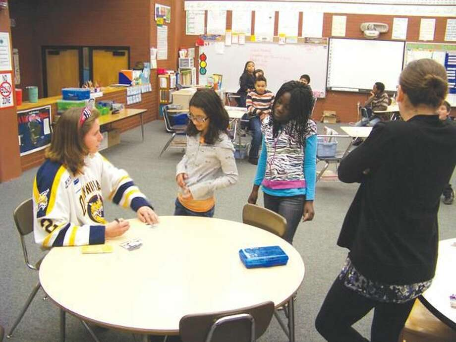Submitted Photo Bethany Dymarczyk, Hamden resident and current member of the nationally ranked Quinnipiac University Women's Ice Hockey team, visited with the fifth-grade classes at Ridge Hill School in Hamden recently.