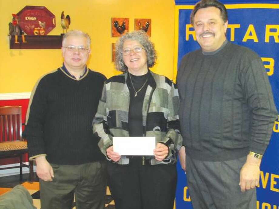 Text & Photo courtesy of David Marchesseault, Rotary Secretary North Haven Rotary Club Past President Luigi Nuzzolillo presents $800 check to Tracey Parks of Domestic Violence Services accompanied by Rotary President-Elect Guy Casella.