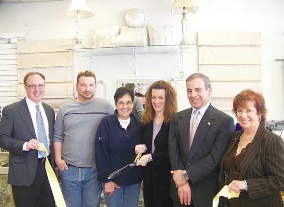 Photo courtesy of Dee Prior, Quinnipiac Chamber of Commerce Left to right: Jim Augur, VP of Anthem and Chairman of the Board Quinnipiac Chamber of Commerce; Marcus Pires; Annette Baisley; Kristine Cebula, owner; First Selectman Mike Freda; and Robin Wilson, President of the Quinnipiac Chamber of Commerce. Missing from photo is Milton Baisley.