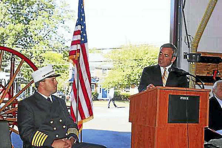 Kate Ramunni — New Haven Register.  North Haven First Selectman Michael Freda, right, speaks at the swearing-in ceremony held at Fire Headquarters for Fire Chief Paul Januszewski, left.