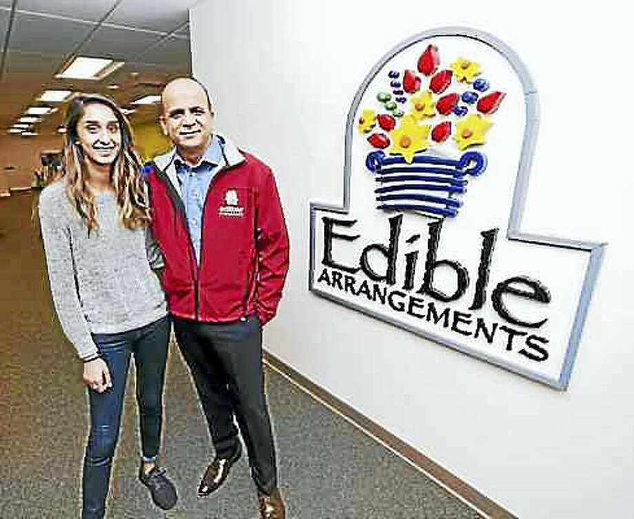 Arnold Gold — New Haven Register. Somia Farid, left, special projects manager for Edible Arrangements, is photographed with her father, Tariq Farid, founder and CEO, at the company headquarters in Wallingford.