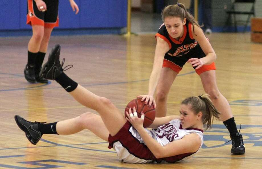 Photo by Russ McCreven Sacred Heart Academy's Marissa Nobile holds onto the ball as she hits the floor in the Pacers' recent SCC tournament game against Shelton.