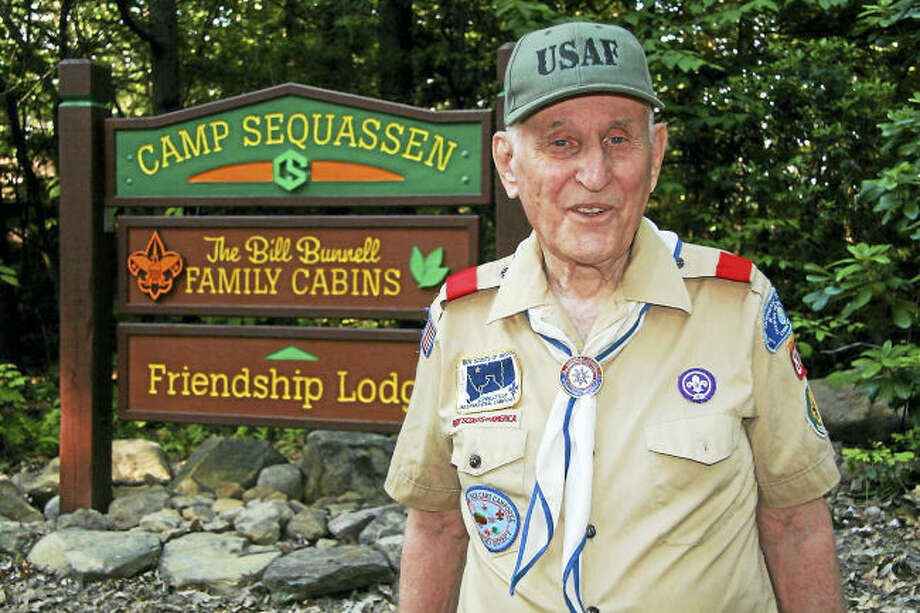 Photo by Tim Clune. Scoutmaster Emeritus Bill Bunnell at the Bill Bunnell Family Cabins at Camp Sequassen Scout Reservation, New Hartford, CT, which have been named in his honor.