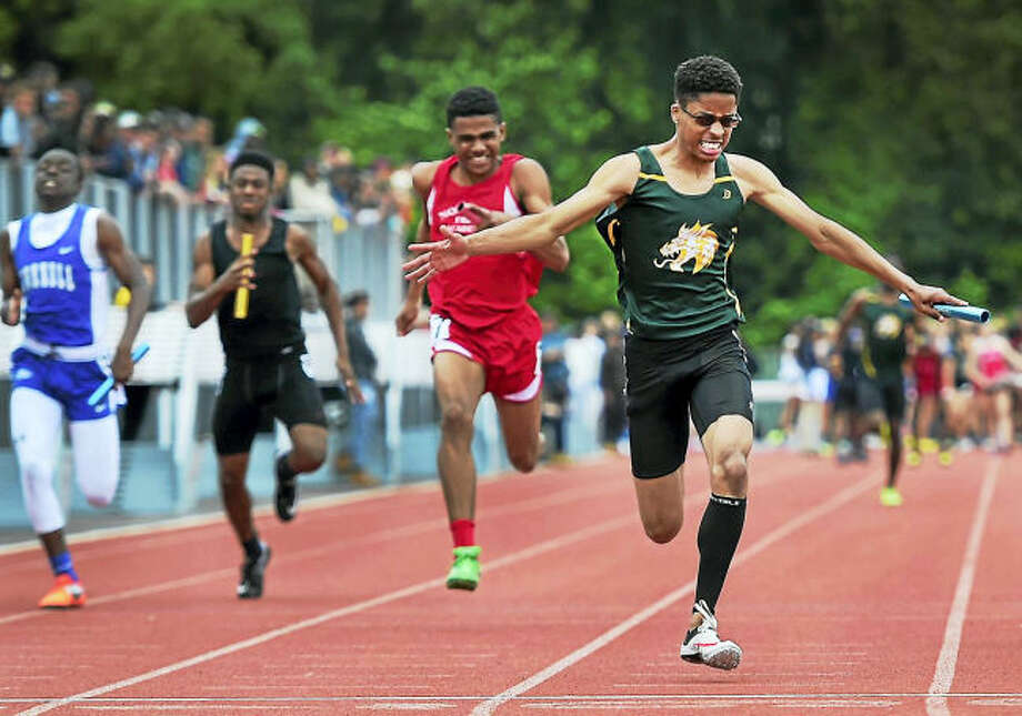 Hamden's Camron Fowlin, right, runs to a first-place finish in the 4x100 relay at the State Open at Willow Brook Park in New Britain on Monday.