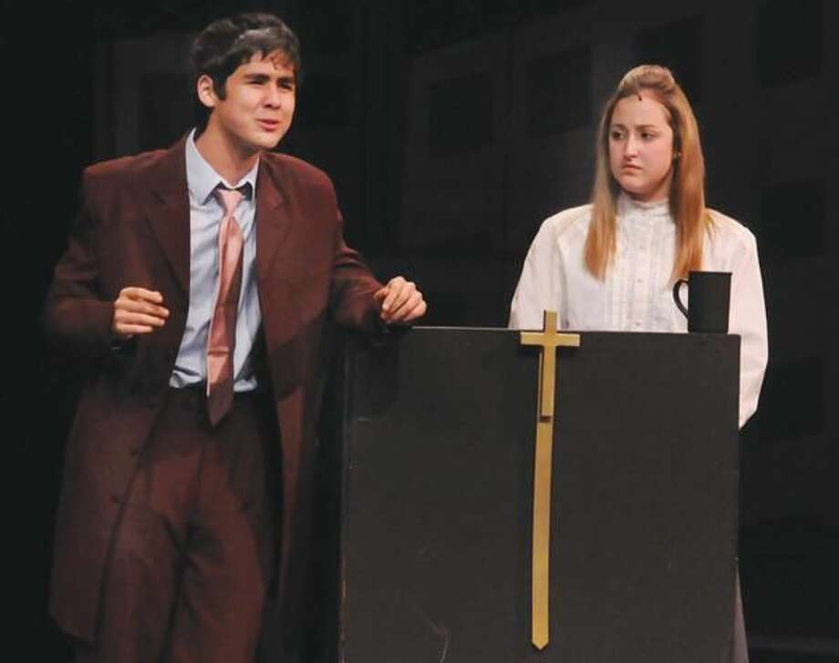 """Photos by Mara Lavitt Pictured is Chris Peters as Sky Masterson and Jessica Coppola as Sarah Brown in North Haven High School's production of """"Guys and Dolls."""""""