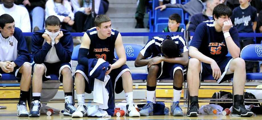 Photo by Arnold Gold/Register Members of the Lyman Hall boys' basketball team look on in the closing minute of Wednesday's Class L tournament semifinal against Northwest Catholic. The Indians won 54-48.