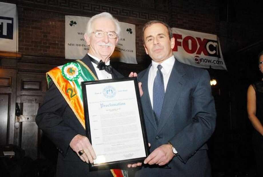 "Submitted Photo First Selectman Michael J. Freda, right, recognized long time resident Walter Nester proclaiming March 5 as ""Walter Nester Day"" at the annual St. Patrick's Day Parade Ball on March 5 at Yale Commons."