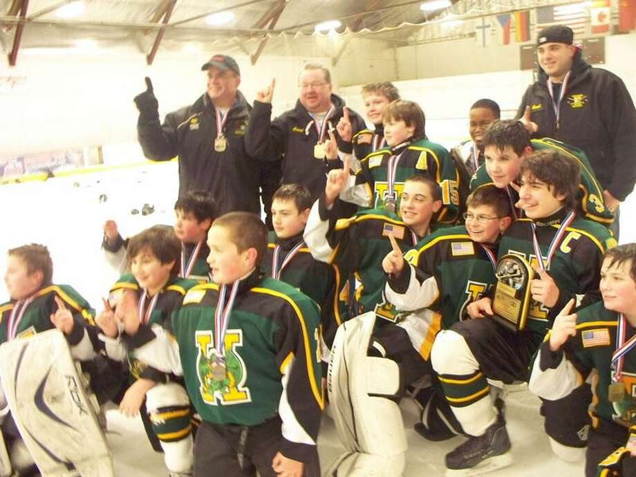 Submitted photo The Hamden Youth Hockey PeeWee B team celebrates its state championship in the Wales Division.