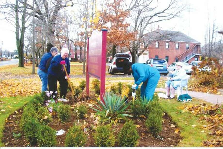 Photo by Gerri Giordano North Haven Garden Club members Annette Bailey, Marie Tiberio, Carmen Sealy and Lois Stover work on the beautification of the Martha Culver Memorial Library.