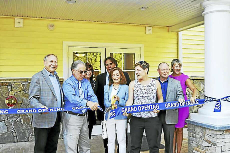 Photo by Clare Dignan / Hearst Connecticut Media. From left, James Pascarella, Louis Tagliatela Jr., Lauren Tagliagela, Dale Kroop, Tricia Tagliatela and Nancy Dudchik cut the ribbon at grand opening of Canal Crossing at Whitneyville West apartment complex in Hamden.