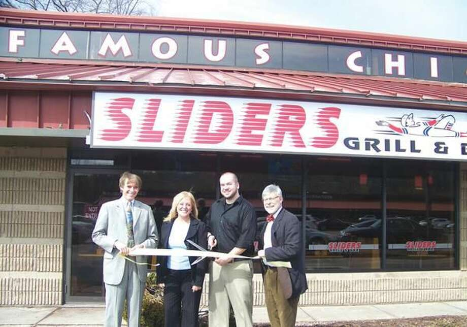 Submitted photo by Dee Prior Mayor William Dickinson; VP Quinnipiac Chamber of Commerce Cindy Semrau; Scott Brophy, Director of Operations; and Al Scafati, Press/Cuozzo Realtors, who contracted this new location and is the former Chairman of the Quinnipiac Chamber board, attend the grand opening of Sliders Grill & Bar.