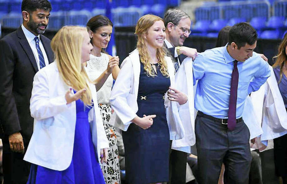 Arnold Gold / Hearst Connecticut Media. The White Coat Ceremony for students in the Frank H. Netter MD School of Medicine at the Quinnipiac Sports Center in Hamden.
