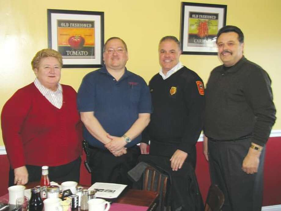 Submitted photo courtesy of David Marchesseault, Rotary Secretary Left to right, Rotary Program Chair Mary Jane Muligan stands beside State Fire Convention Chair Ronald Mattei, North Haven Fire Chief Vincent Landisio, and Rotary President-Elect Guy Casella.