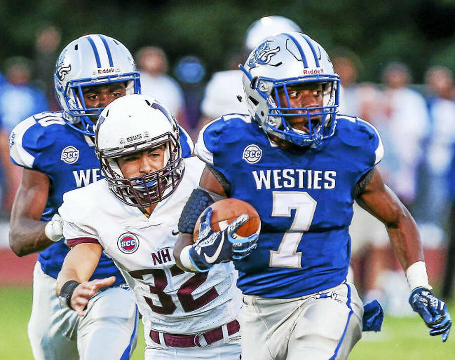 (John Vanacore/For Hearst Connecticut Media) West Haven's Kyle Godfrey(7) outruns North Haven's Devan Brockamer(32) for a big gain during the Blue Devil's 33-27 Friday night.West Haven's Kyle Godfrey (7) outruns North Haven's Devan Brockamer for a big gain on Friday.