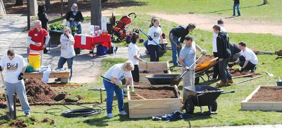 """Photo by Mara Lavitt Ridge Hill School in Hamden was the site of a """"Dig In"""" where raised vegetable beds, irrigation, and a butterfly garden were built or renovated by QU students, parents, faculty and school andtown administrators. 4/9/11"""