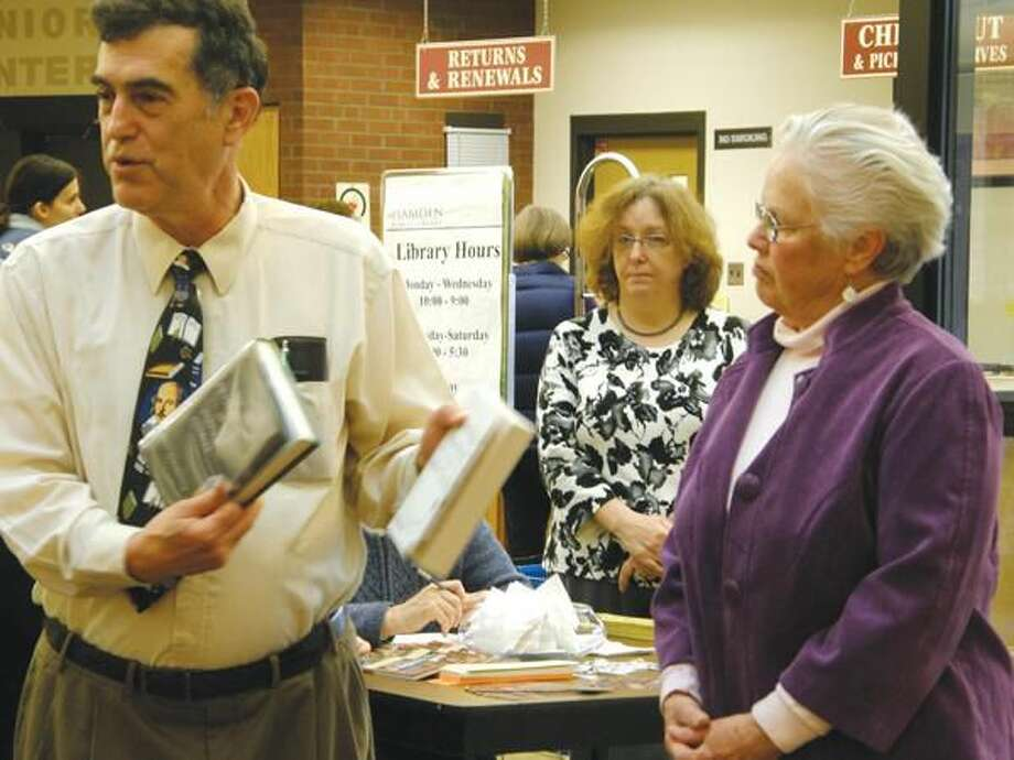 Submitted Photo Library Director, Robert Gualtieri, displays books honoring Peg Limbacher as Volunteer of the Year.