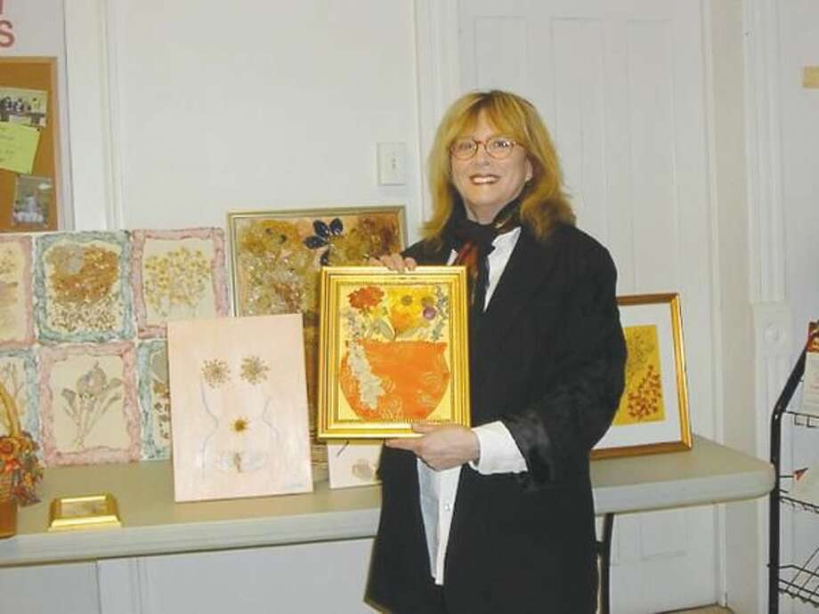 Submitted Photo Lisabeth Billingsley with her pressed flower collages at the Wallingford Garden Club's April 12 meeting.