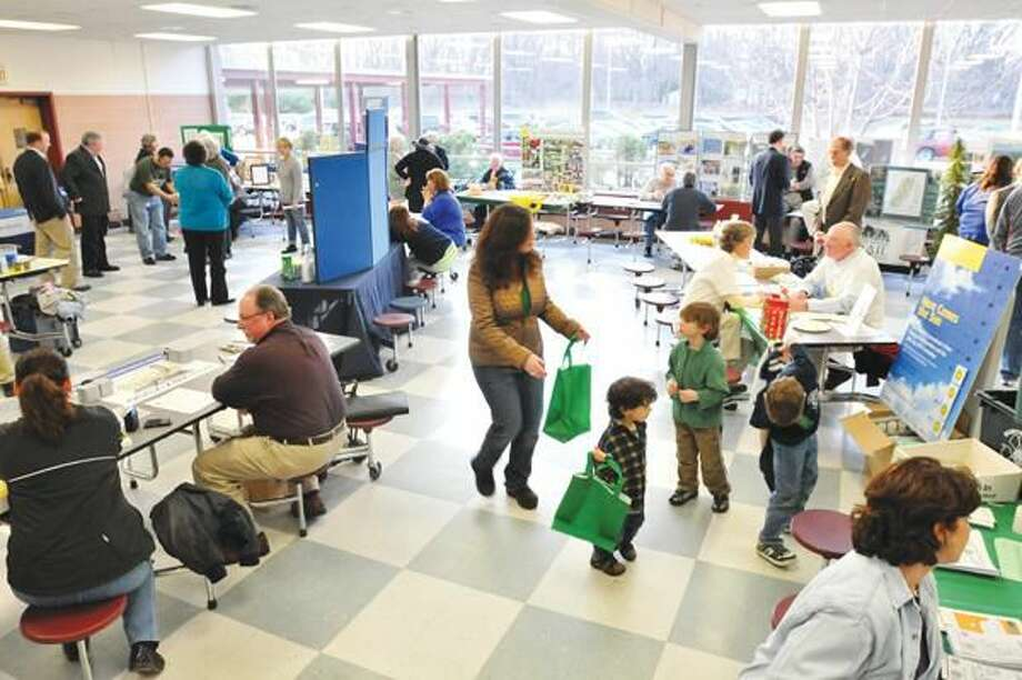 """Photo by Brad Horrigan The """"business room"""" featured green local businesses at the North Haven Earth Day celebration Friday at North Haven Middle School."""