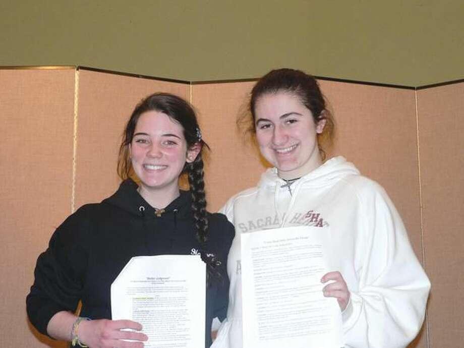 Photo courtesy of Elizabeth Christophy Sacred Heart Academy Authors Samantha Bowers, left, and Mikayla Zagata.