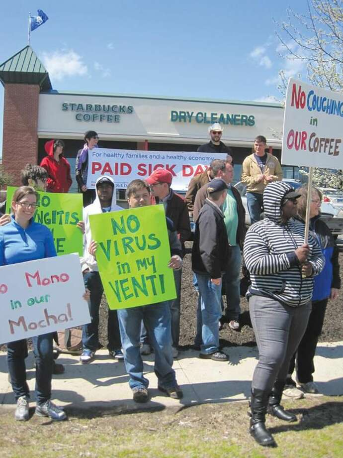 """Submitted Photo Holding signs with slogans like """"No Coughing in Our Coffee"""" and """"No Viruses in Our Ventis"""", the EverybodyBenefits.orgcampaign for paid sick days rallied outside a Hamden Starbucks at 2100 Dixwell Ave. last week."""
