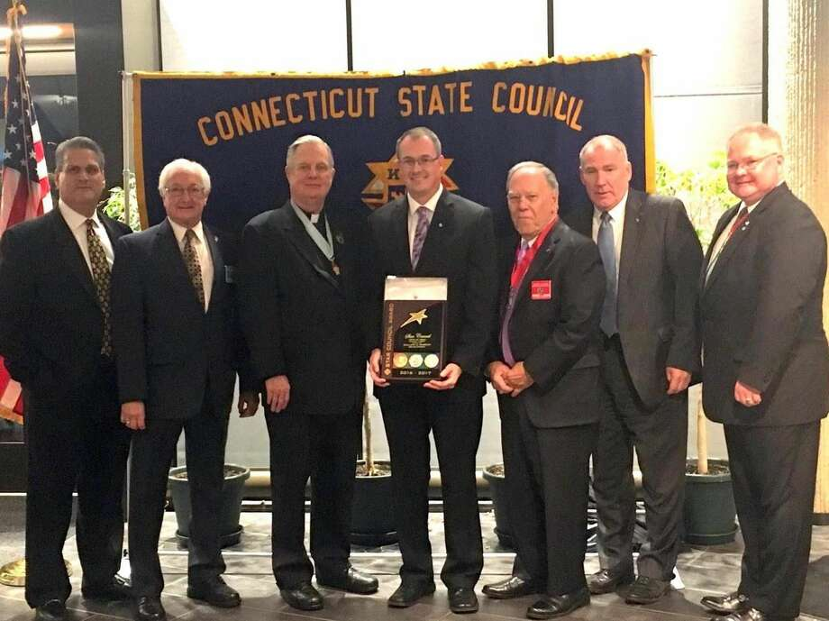 From left, Jon Starr, General Agent, Ron Cimini, District Warden, Msgr. J. Peter Cullen, State Chaplain, Tim Freer, Council Deputy Grand Knight , George Zocco, District Deputy, Edward Broderick, Field Agent, Steven Bacon, Ct. State Deputy.