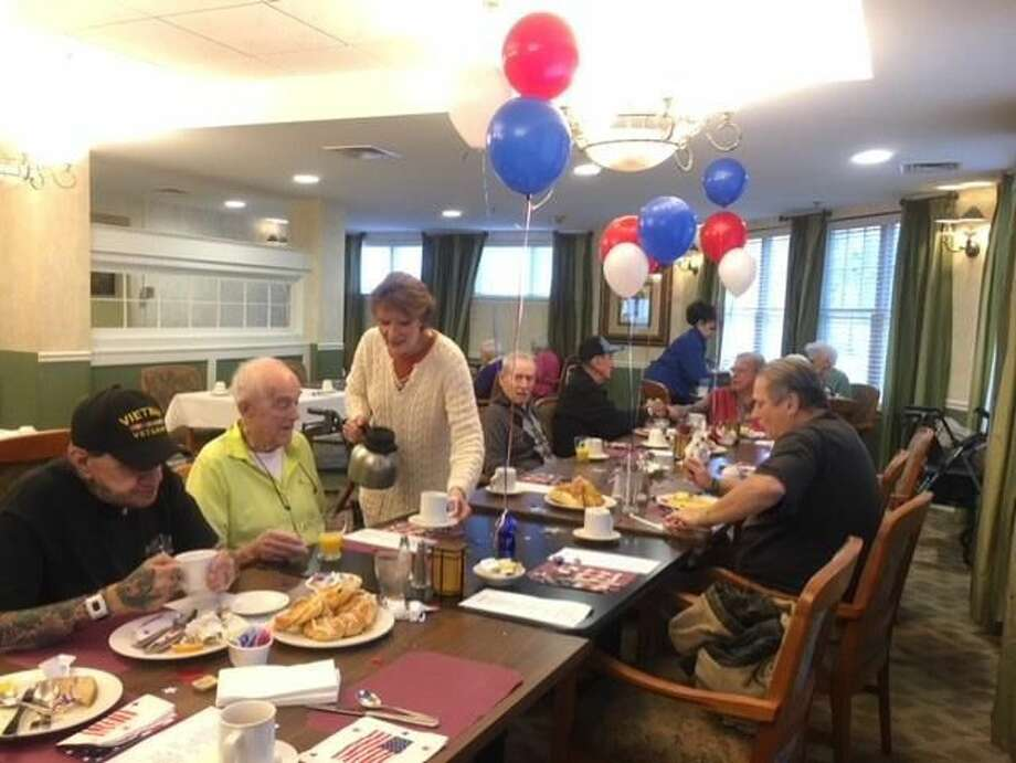 Veterans and friends enjoy the food and fellowship at the breakfast.