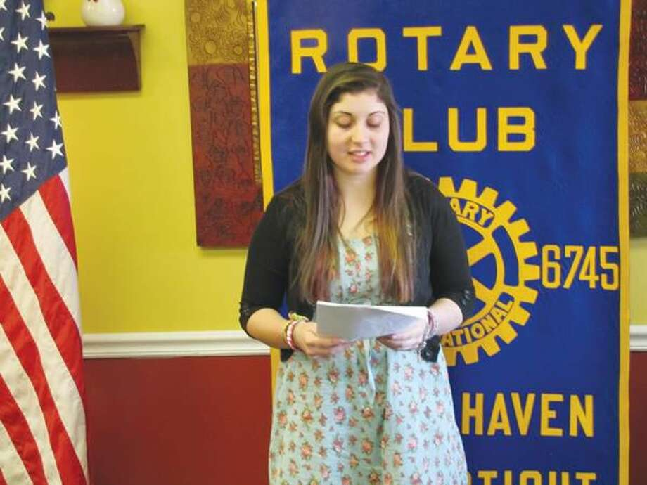 Submitted photo courtesy David Marchesseault, Rotary Secretary Viviana Torres presents her winning speech which decried the unreasonable degree of opposition in the country against immigration.