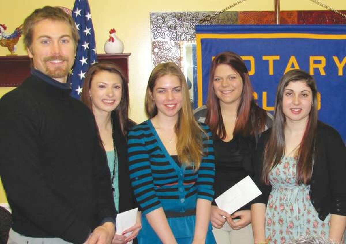Submitted photo courtesy David Marchesseault, Rotary Secretary The Four-Way Test Advisor, Peter Sagnella, was honored by the North Haven Rotary Club with local prize winners Heather Piscatelli, Jennifer Royka, Samantha Manns, and Viviana Torres, local champion.