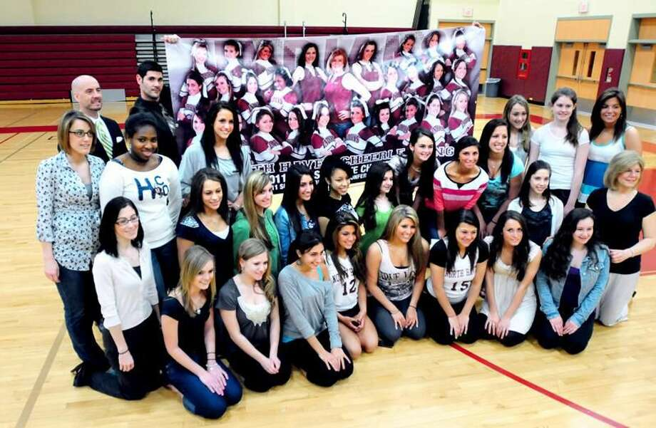 Photo by Arnold Gold The North Haven High School cheerleading squad photographed in front of a team banner in gymnasium of North Haven High School Wednesday. The team won the 2011 Class L State Championship and SCC Championship.