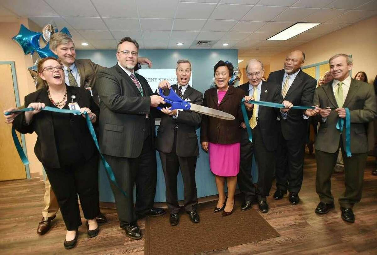 Dr. Alice Forrester, CEO; Dr. Pieter Joost Van Wattum; Hamden Mayor Curt Balzano Lang; Tom Sandone; New Haven Mayor Toni N. Harp; state Sen. Martin Looney; Commissioner Roderick Brembry; and North Haven First Selectman Michael Freda cut the ribbon at the grand opening of the Clifford Beers Marne Street Clinic in Hamden Thursday.