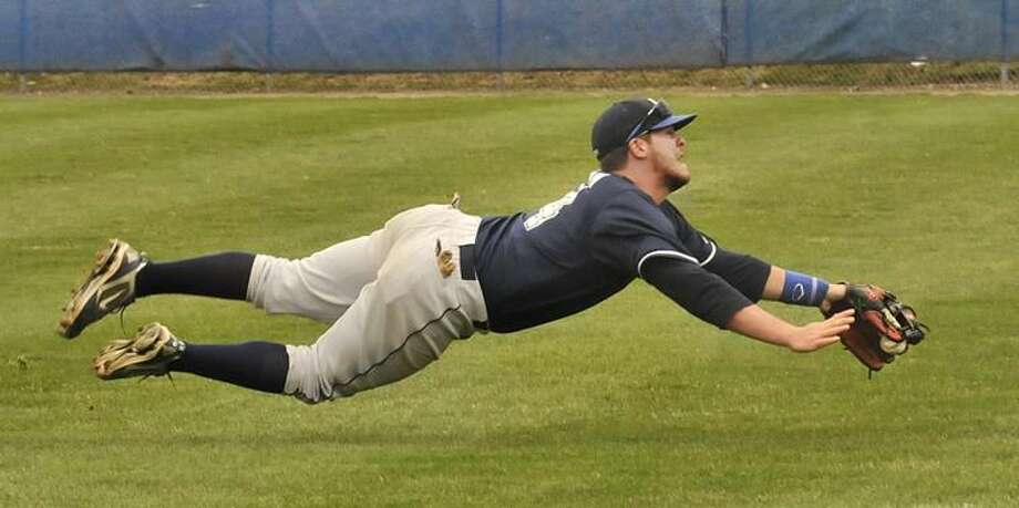 Photo by Melanie Stengel/Register Southern's T.K. Kiernan, of Wallingford, dives for a shot by UNH's Brendon Buckley in the third inning. Kiernan lost the ball upon landing. Buckley was left stranded on base in the inning.