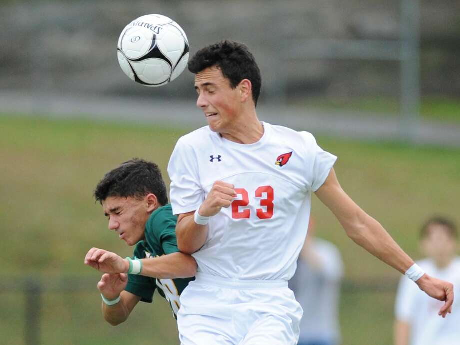 Hamden's Michael Lanouette II, left, and Greenwich's Martin Garcia rise up for a header their Class LL state tournament game Monday at Greenwich High School. The Cardinals won 2-0.