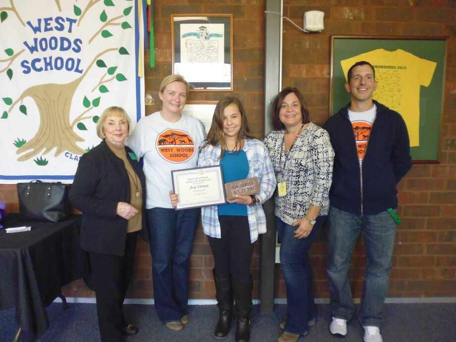 Shown with Ava are Rotarian Betsy Gorman (left), West Woods School Principal Michelle Coogan and teachers Lauren Mollin and Michael Virginelli.