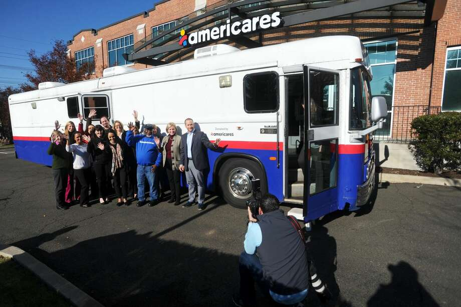 Americares staff bid farewell to its mobile clinic, which is being sent to the Ponce Medical School Foundation in Puerto Rico to provide outreach for survivors of Hurricane Maria, during a sendoff ceremony at the Americares headquarters on Hamilton Avenue in Stamford, Conn. on Tuesday, Nov. 28, 2017.