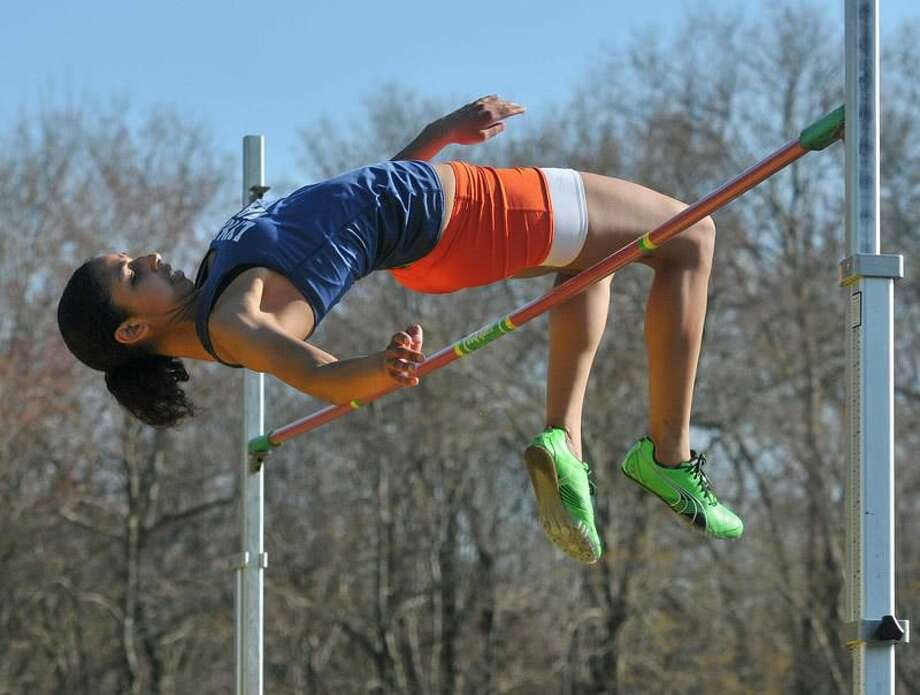 Photo by Brad Horrigan/Register Lyman Hall's Ronea Saunders won the high jump at Tuesday's meet at Amity.