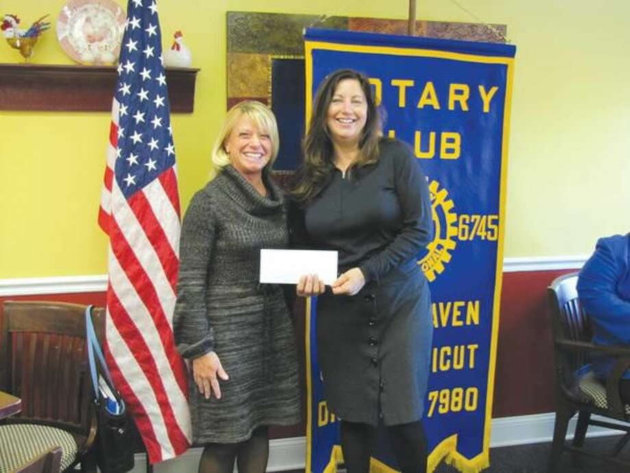 Photo courtesy of David Marchesseault, Rotary Secretary Theresa Veile (right), a past president of the North Haven Rotary Club, presents the club's $800 donation to Amy Russell of Yale/ New Haven Hospital's Tommy Fund.