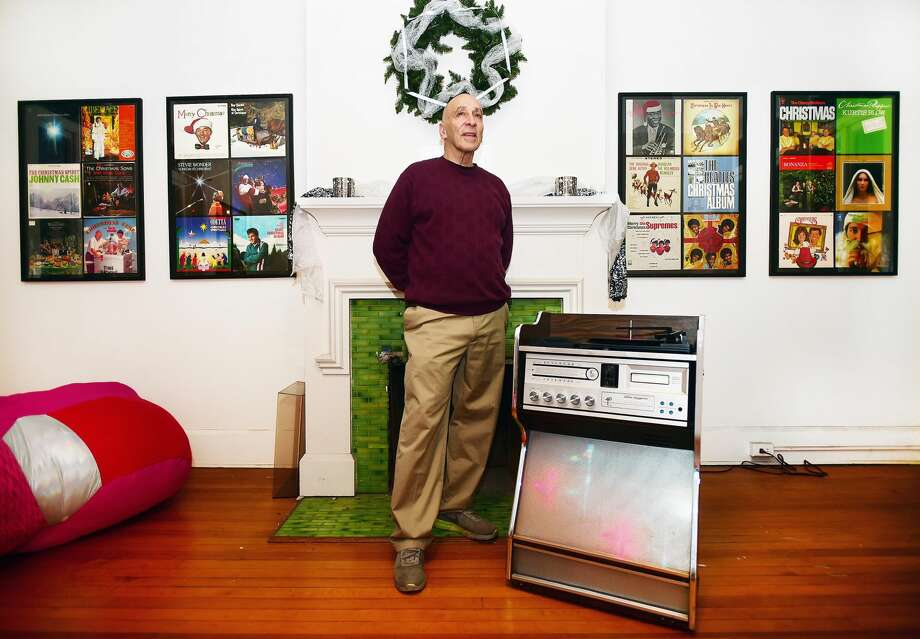 Sam Goldenberg plays an album on his 1970's Morse Electrophonic Jukebox, surrounded by his collection of Christmas music on exhibit at the John Slade Ely House at 51 Trumbull St. in New Haven.