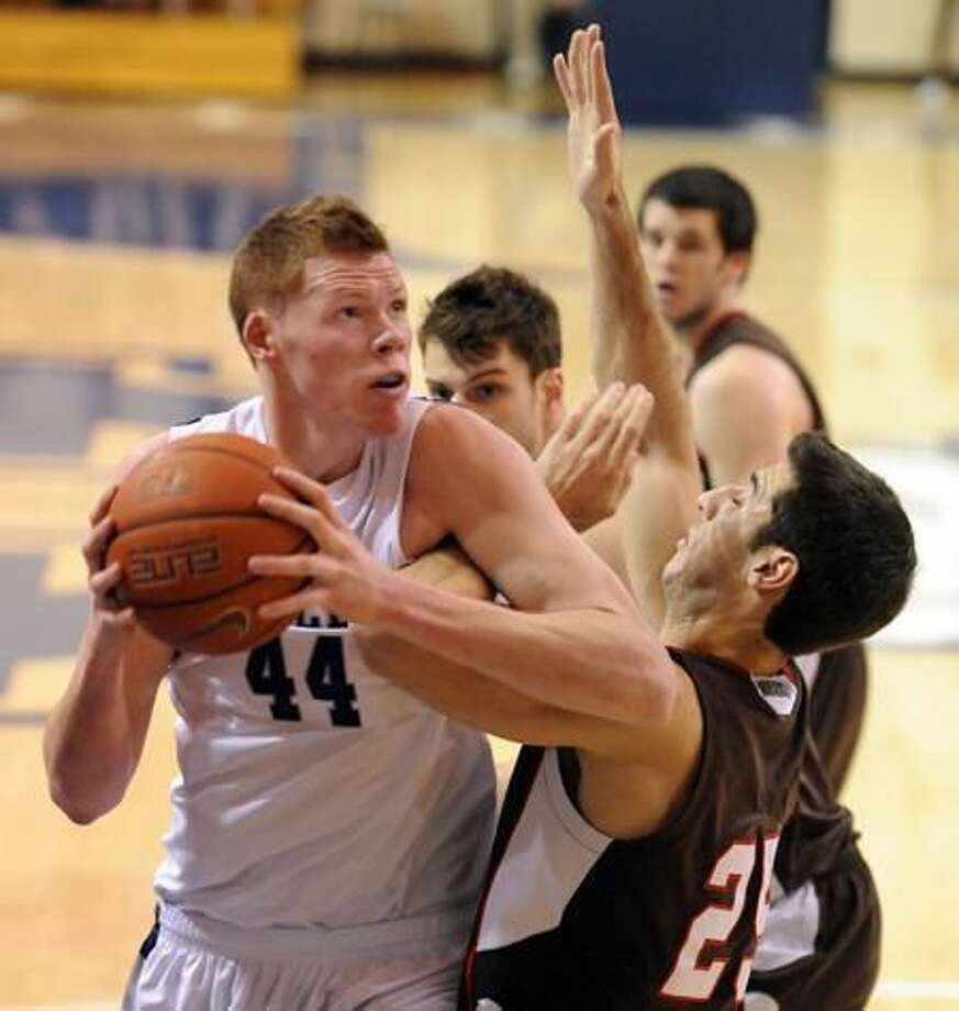 File photo by Mara Lavitt/Register Yale's Greg Mangano powers his way inside in a game against Brown.