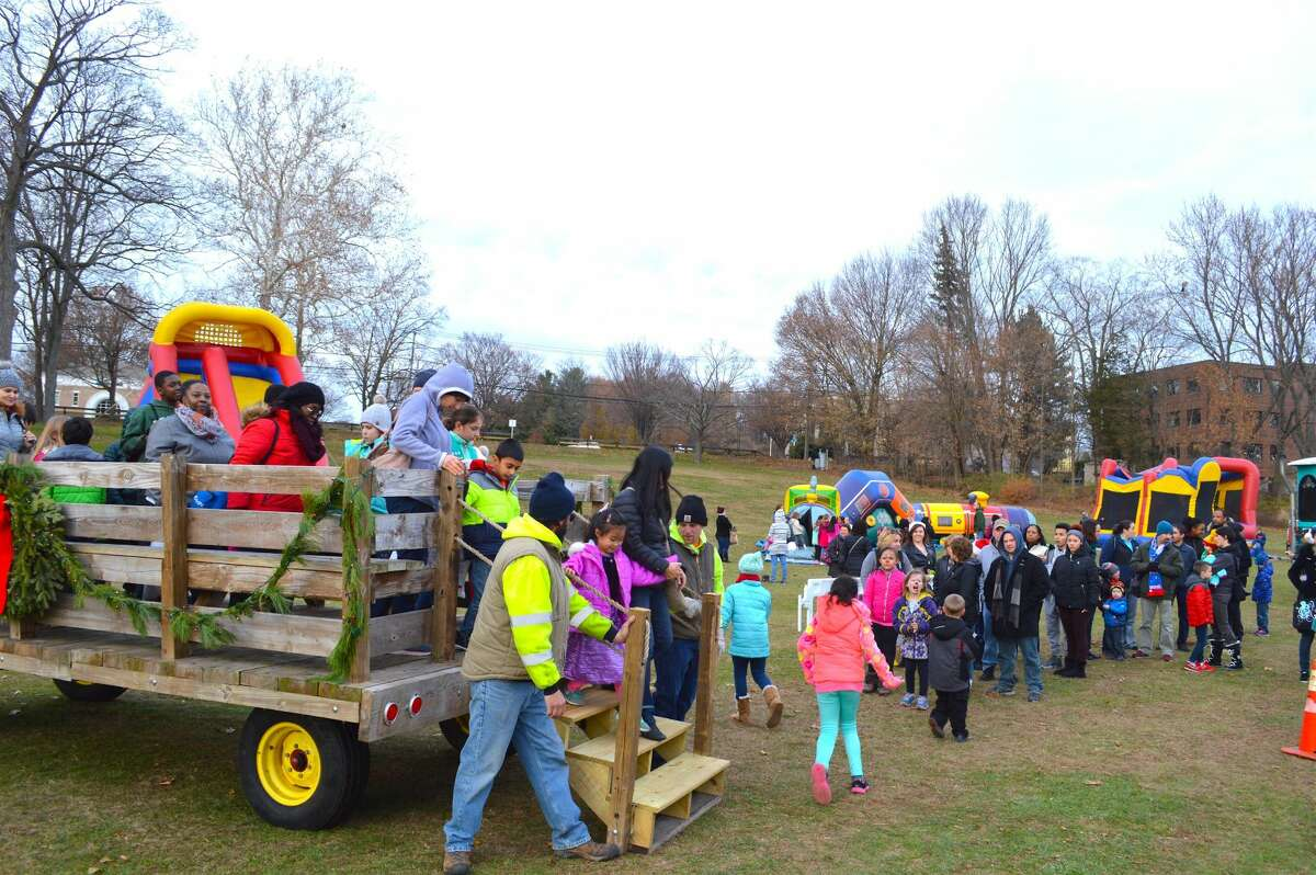 The Parks Department, one of many civic participants at the Silverbells Holiday Festival, ran a hayride for visitors to Town Center Park Saturday afternoon.