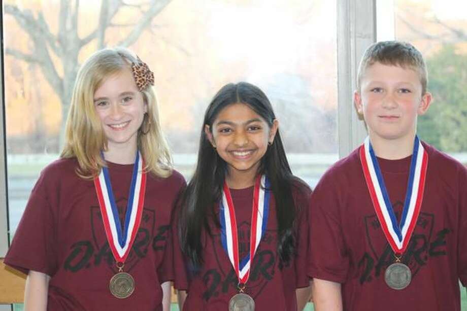 Submitted Photo Pictured are the three winners of the D.A.R.E. essay contest, they are, from left to right, Jessica Thomas, Niti Bidja, and Zachary Orth.