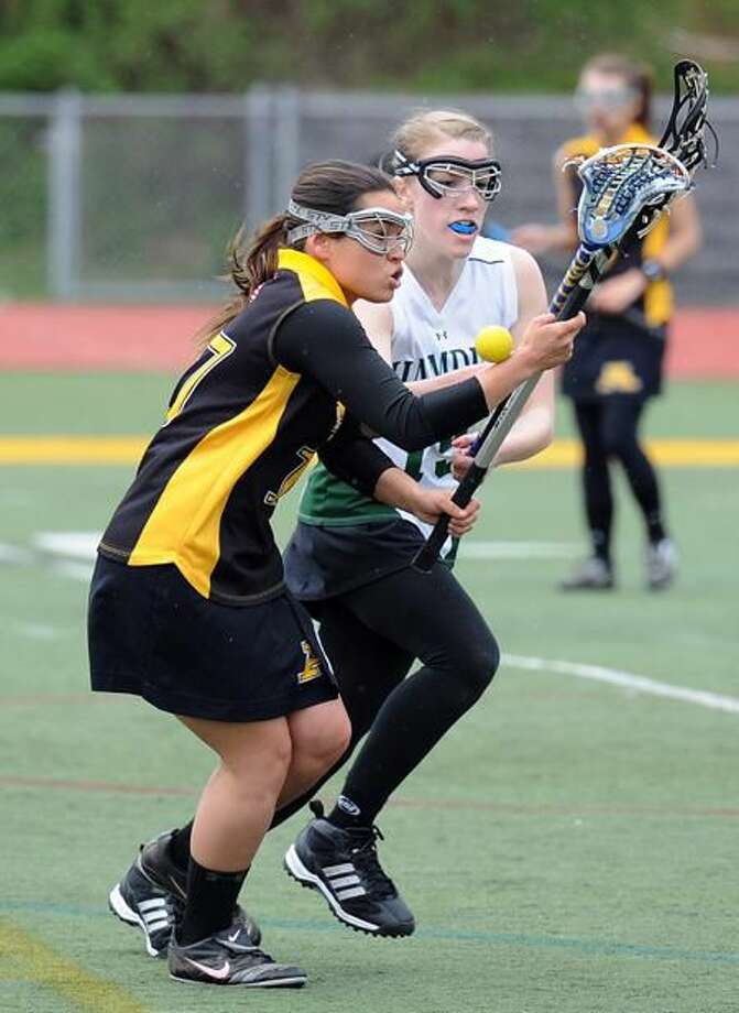 Photo by Peter Casolino/Register Amity's Samantha Moscato battles with Hamden's Jenna McPhail.