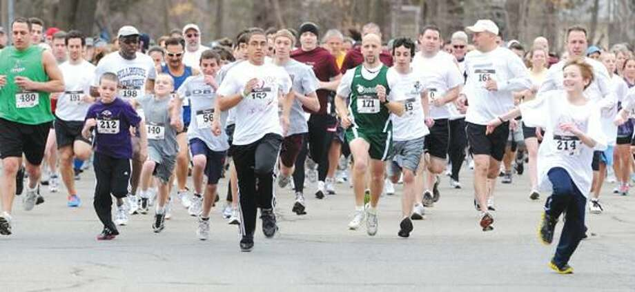 Photo by Mara Lavitt The North Haven PTSA held a fundraising road race Sunday at North Haven Middle School. Here's the start of the 5K part of the morning's events.