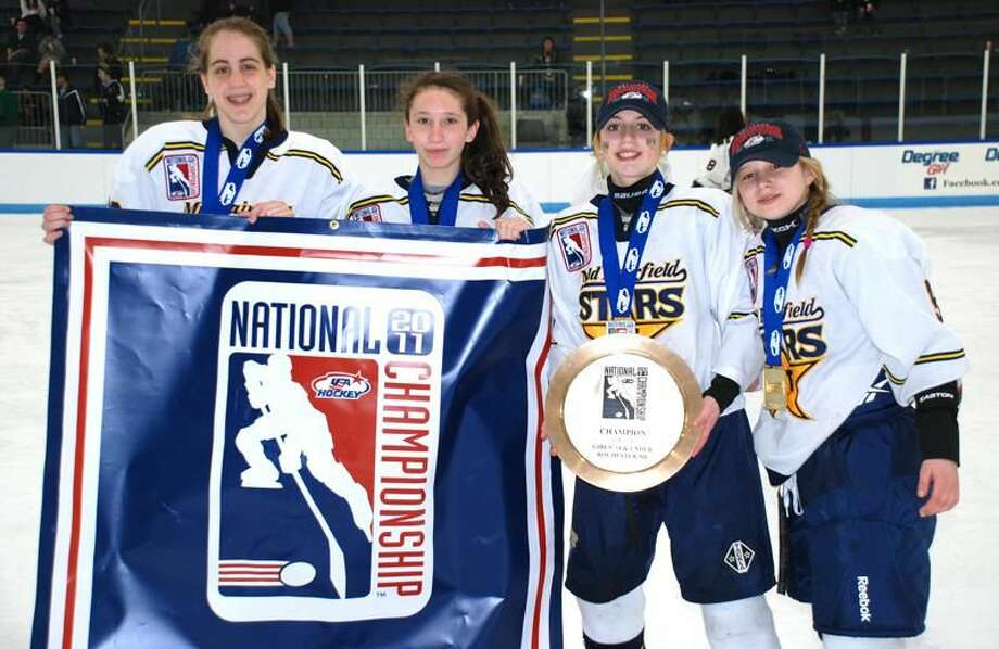 Submitted photo Local players, from left to right, Kate Pantera (North Branford), Lauren Ferraiuolo (North Haven, Ashley Carbone (North Haven) and Madison Jerolman (Hamden) helped the Mid Fairfield Connecticut Stars Under-14 Tier I girls' ice hockey team bring home the national championship.